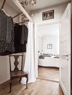 Ladder clothes hanging idea..with a curtain on a track.