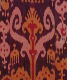 SILK IKAT PANEL, UZBEKISTAN, 20th C. Red, pink, purple and yellow with stylized arrows and botehs, colorful woven border, backed in printed paisley cotton. 78 x 60.