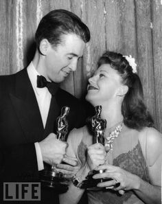 Stewart and Rogers congratulate each other for their Best Actor and Actress wins at the 1941 Academy Awards dinner. He wins for The Philadelphia Story, she for Kitty Foyle.