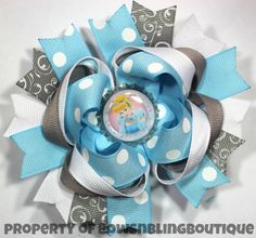 """I love this super cute Cinderella inspired hair bow! The bow is layered with vibrant colors and beautiful ribbon. Each bow pictured measures approximately 4.5""""- 5"""" across. It is perfect for babies, to"""