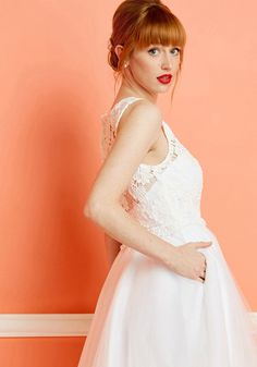<p>In this white midi - part of our ModCloth namesake label - you look and feel fit for a fairytale. And, on your special day, that's 'awe' you need. With a crocheted lace bodice, an illusion sweetheart neckline, back buttons, and a voluminous tulle skirt, this dress embodies the magic of which you always dreamed - what 'luxe'!</p>