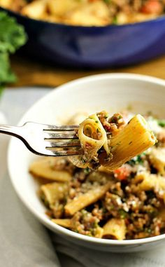 Rigatoni Salsiccia e Rapini...an easy-to-make Italian pasta recipe with sausage and broccoli rabe that is perfect for busy weeknight dinners, and elegant enough for a special occasion.