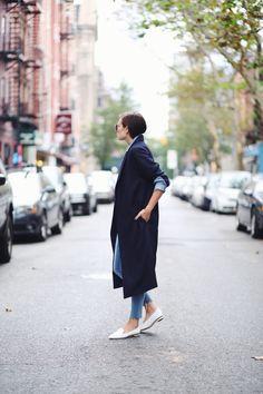 Danielle Bernstein | Dark blue long cardigan | Light blue denim shirt and jeans | White pointy flats