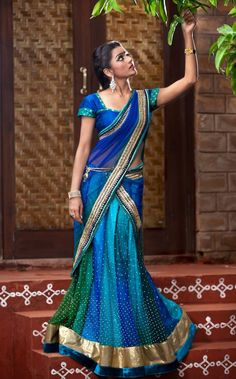 Blue-green half saree. Indian fashion.