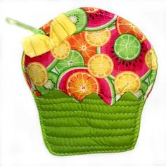 """These sweet treats are made for your kitchen! Comes in a variety of colors and patterns. This particular hot pad is Green, Yellow and Pink  Lemon, Limes and watermelon """"icing"""" pocket adorned with a Yellow bow with a unique White thread design featuring a Green ribbon. The Green base """"wrapper"""" is quil"""