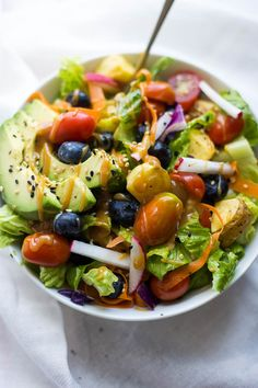 The Big Vegan Rainbow Bowl with Maple Almond Butter Dressing: featuring fruits, vegetables, and an addictive maple almond butter dressing! The perfect healthy, gluten free, and vegan summer salad!    fooduzzi.com recipe