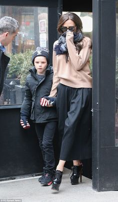 Protective mum: The 40-year-old star emerged hand-in-hand with nine-year-old Cruz...LOVE THE SHOES!
