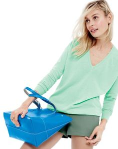 J.Crew Collection featherweight cashmere V-neck boyfriend sweater, women's cotton twill short in faded vine, stone trio ring, and new Uptown tote bag.