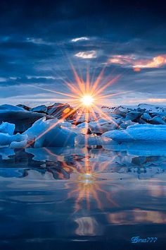 Glorious sunset over the beautifiul blue ice. Pretty reflections from the sun over the water. The sun rays are gorgeous. Beautiful Sunset, Beautiful World, Stunningly Beautiful, Pretty Pictures, Cool Photos, Landscape Photography, Nature Photography, Nature Landscape, Photo Images