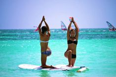 Yoga on Paddleboards somewhere tropical