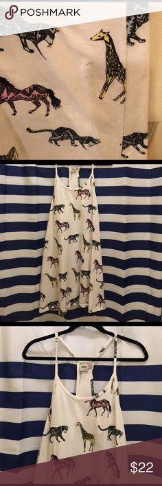 Racer Back Safari Critters Dress/Swim Coverup Awesome safari animal patterned racer back dress from ASOS. 100% cotton. Could be worn as a dress with a racer back camo underneath or a bandeau/bralette. NWOT- Originally purchased as a swim cover up for vacation and never worn. Does have one mystery spot on the back right side near the giraffe on the seam. No other issues. The cut is swingy and floats away from the body. ASOS Dresses Mini