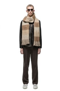 - Italian fabric - 73% Virgin Wool 10% Alpaca 10% Mohair 7%PA - Soft brushed texture - Wide tonal stripes - Large stitched seam - Tasselled ends  Our Brushed Scarf in Brown Stripe. Produced in a soft brushed Italian tonal striped fabric this wide and long scarf features a large stitched side seam and tasselled ends.  Scarf measures 244cm x 38cm when laid flat.