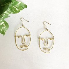 ALSO AVAILABLE IN SILVER! PLEASE SELECT SILVER FROM THE OPTION MENU WHEN PURCHASING. -------- FACE wire dangle earrings | abstract face drop earrings | face dangles | statement earrings | wire face earrings | picasso face earrings These earrings are lovingly hand-shaped out of Clean Gold Jewelry, Cleaning Silver Jewelry, Silver Jewelry Box, Cute Jewelry, Silver Rings, Silver Bracelets, Face Earrings, Diy Earrings, Statement Earrings