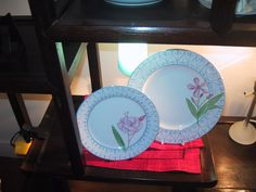 Limoges porcelain hand painted plates, with laurel pink flowers, and sky blue border