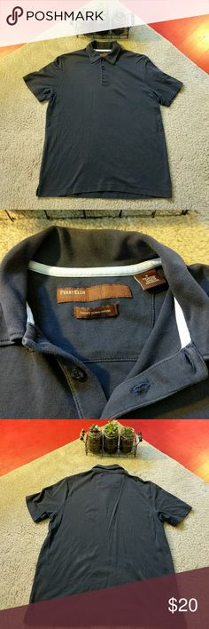 Perry Ellis navy pima cotton polo Color: navy blue  Description: 100% luxury Pima cotton makes this shirt INCREDIBLY soft! Traditional polo great for any occasion. Pre-loved w/ very minor fading, lots of life still in this bad boy!  Always open to offers/questions! Discounts for bundles of 2+ items :) Perry Ellis Shirts Polos
