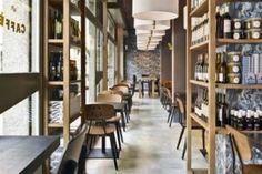 Filling Station Motel Garage and Concept store by Visual Display, Udine – Italy Design Blog, Store Design, Cafe Design, Brown Cafe, Retail Solutions, Filling Station, Iron Table, Vogue, Visual Display