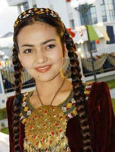 A girl in her traditional costume from Turkmenistan