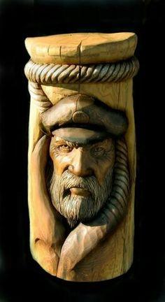 Sea Captian - carved into stump?