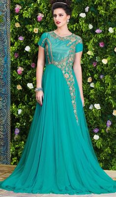 Cast a spell over the masses with this turquoise color net floor length Anarkali churidar suit. This enticing attire is displaying some incredible embroidery done with lace, stones and resham work. #longchuridaranarkali #adorableanarkalidesigns #gloriousanarkalisuits