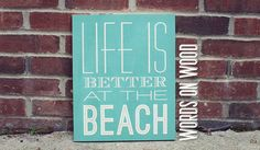 """Wall Art :: Wooden Wall Art :: Wood Art :: Inspirational Quotes :: Signs with Quotes :: Wooden Sign that saying """"Life is Better at the Beach"""". A perfect Wooden Sign for that place you call home, or home away from home. Great beach house decor. Choose your color and size to make it perfect for your space :: WordsOnWood.com"""