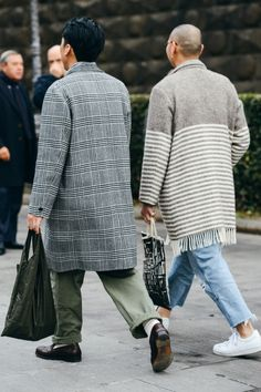 http://chicerman.com  billy-george:  The back of some awesome coats!  Photo by Tommy Ton  #streetstyleformen