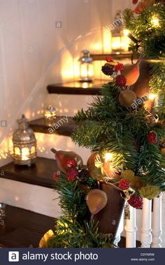 Download this stock image: Lanterns and Christmas garlands adorn a wooden staircase and banister - C0YNRW from Alamy's library of millions of high resolution stock photos, illustrations and vectors.