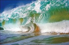"""""""Bulldozer"""" Wave    From: Nature's Best Photography    """"A large, 'doubled-up' wave approximately ten feet high was about to break in water two to three feet deep. The force of the wave picked up large quantities of sand off the sea floor and sucked it into the body of the wave, adding color and texture to the otherwise clear water.""""    Photographer: Clark Little"""
