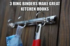 Hang the metal piece from a broken 3-ring binder to make a set of hooks.