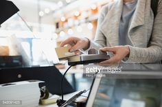 Stock Photo : Customer paying at credit card reader in market