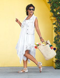 Sun-kissed styling in an easy-wearing silhouette, this smocked tube dress is gorgeous pick for your on-the-go Summer. Beautifully detailed with a laser-cut handkerchief hem, the smocked top keeps the fit secure for all-day comfort. Simply add your favorite accessories and prepare for compliments! lanebryant.com