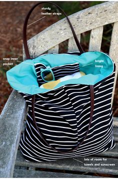 DIY: summer beach bag with leather straps...hmm what about using skinny belts from the gdub for straps & long large skirts with fab prints for the exterior/interior contrast? or, nice durable cotton oxfords?