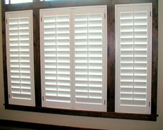 White Plantation Shutters With Dark Window Frames And