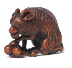 A wood netsuke of a goat By Tomotada, Kyoto, late 18th/early 19th century