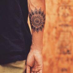 Mandala flower on forearm by Tattooist Grain