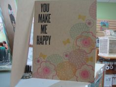 Kraft paper card with stamped flowers and gold stamped butterflies at Paper Tales, San Diego