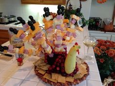 Thanksgiving appetizer made with an eggplant, crookneck squash, strung cranberries, whole clove eyes and pimento waddle. The feathers are ham, cheese and olives. The turkey is surrounded by crackers. Happy Thanksgiving!! #Artsandcrafts #Artsandcrafts