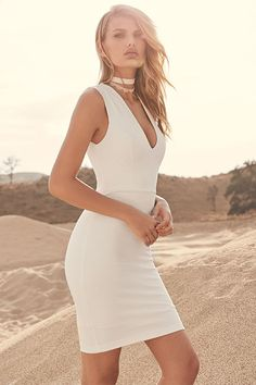 In the Love the Limelight White Dress, you'll always be the center of attention! This stretch knit number has a princess-seamed bodice, with sleeveless style and a deep V-neckline. Bodycon skirt takes over at the waist, and drops to a perfectly modest length. Exposed gold back zipper.