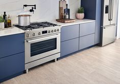 """With a bold, heavy-duty look and die-cast metal front control knobs as well as pedestal feet, this range makes a beautiful focal point in any kitchen. 30"""" and 36"""" gas and dual fuel options Stainless steel and black stainless steel options Easy to install freestanding design Easy to clean enamel surface and dishwasher safe grates Power and precision with dual flame burner Kitchen Oven, Big Kitchen, Kitchen Cabinets, Laundry Appliances, Home Appliances, Freestanding Oven, Electric Oven, Oven Range"""
