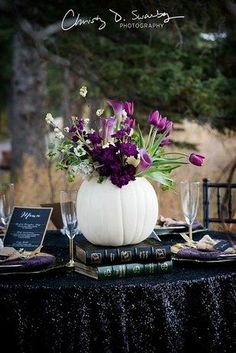 Use white pumpkins, gold skulls, and black sequins for a chic look. Use white pumpkins, gold skulls, and black sequins for a chic look. Halloween Wedding Decorations, Halloween Themes, Halloween Weddings, Halloween Wedding Flowers, Pumpkin Wedding Centerpieces, Wedding Pumpkins, Purple Centerpiece Wedding, Fall Pumpkin Wedding, Halloween Table Settings