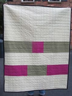 Simple straight line grid quilting. I like the variations in the quilting pattern. Like the cream color too.