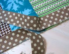 """GREAT binding tutorial- fold binding in half and zig-zag raw edges together, line up edge with raw edge of quilt and sew with 1/4"""" seam allowance, flip binding up and iron away from quilt, fold binding on to back side and pin just over stitch line you just made, stitch in the ditch front side up, removing pins on back as you go."""