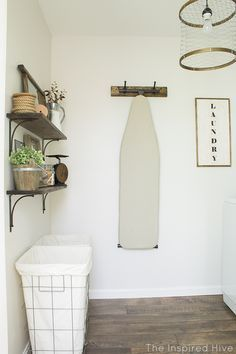 A rustic industrial style laundry makeover with lots of easy DIY decor ideas!