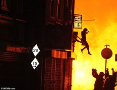 A woman jumping from a burning building in Surrey Street, Croydon, while fires rage around her