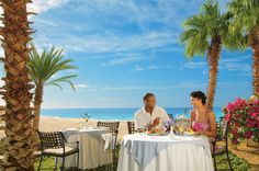 An elegant beachside meal is the perfect way to relax with a loved one at Dreams Los Cabos. #UnlimitedRomance