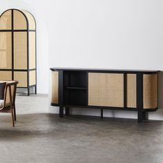 Dark teak wood and soft honey rattan tie in traditional materials with a modern sideboard design. Black Sideboard, Modern Sideboard, High Quality Furniture, Teak Wood, Beautiful Interiors, Household Items, Sliding Doors, Cool Furniture, Rattan