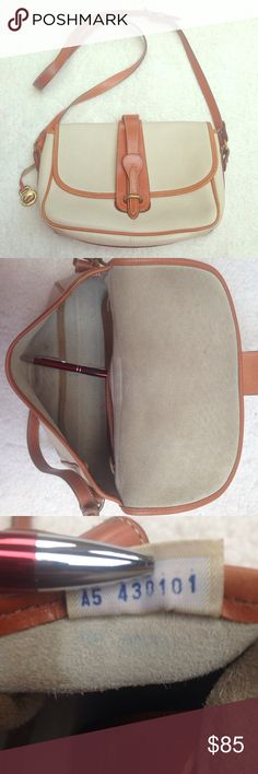 """Sale 🦃 Rare Dooney & Bourke Crossbody Bag 💼 All weather leather EQUESTRIAN Crossbody purse. Vintage and rare in very good shape, will last you a lifetime. 👜💼👛👜💼👛👜💼sign of use include normal overall darkening of tan trim; few light scuff marks, ink marks inside and back pocket, darkening of leather from use inside, strap has a small green discoloration. 👜Dimensions: 10.5"""" L x 7.5"""" H x 3.5"""" W. 👛Interior: 6 credit card slip pockets, 1 zip pocket. 💼Exterior: 1 large back slip…"""