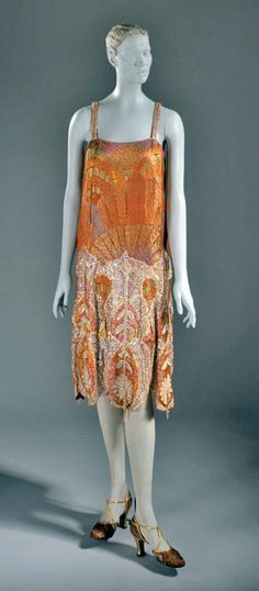 Evening dress, Callot Soeurs, ca. 1925. Sequins and glass beads on silk and metallic brocade with metallic lace and beaded tassel trim. Los Angeles County Museum of Art