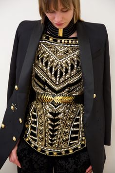 Trying on a breathtaking ensemble featuring all of the Balmain signatures. Gold, velvet, embroidery, pearls, strong, tailored shoulders and a defined waist – Parisian opulence at its finest. #HMBALMAINATION | Balmain x H&M