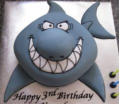 Shark Cake @nikki striefler Ward My friend had a shark party last weekend and they had a cake based on this one. So cute!! (I saw you were pinning shark cakes :-D )