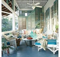 Old South meets Caribbean...love the shutters! And there are the bottles I want to make in to lights!